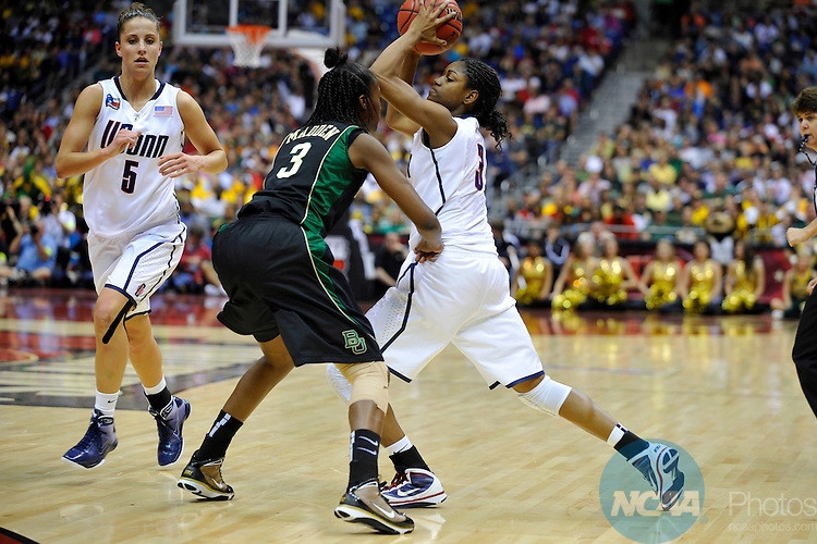 04 APR 2010: Tiffany Hayes (3) of the University of Connecticut drives toward the basket while Jordan Madden (3) of Baylor moves in to stop her during the Division I Women's Basketball Semifinals held at the Alamodome during the 2010 Women's Final Four in San Antonio, TX.  Stephen Nowland/NCAA Photos