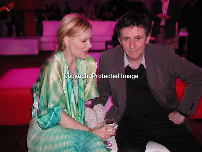 Gabriel Byrne and girlfriend<br />