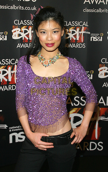 VANESSA MAE.The Classical Brit Awards Nominations Party at The Landmark Hotel, London..April 21st, 2004.half length flowers floral necklace jewellery hand on hip purple sequined top.www.capitalpictures.com.sales@capitalpictures.com.©Capital Pictures.