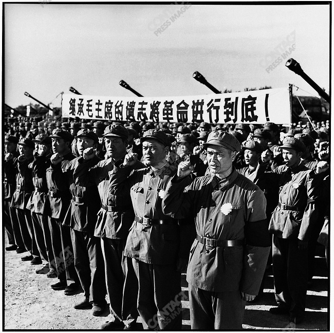 Leng Pengfei, a hero in the Zhenbao Island battle in the Wusuli River, leads PLA troops in a march to mourn Chairman Mao's death. Harbin, 16 September 1976..