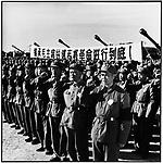 Leng Pengfei, a hero in the Zhenbao Island battle in the Wusuli River, leads PLA troops in a march to mourn Chairman Mao's death. Harbin, 16 September 1976..