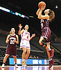 Maryann Bagonis #11 of Mepham, right, shoots from inside the paint during a Nassau varsity girls basketball game against MacArthur at NYCB Live's Nassau Coliseum in Uniondale on Saturday, Dec. 23, 2017. Mepham won by a score of 45-40.