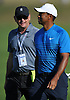 Tiger Woods, left, walks the course alongside player manager Rob McNamara during a practice round prior to the U.S. Open Championship at Shinnecock Hills Golf Club in Southampton on Tuesday, June 12, 2018.