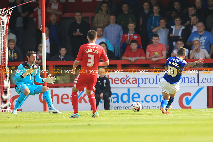 Charlie Macdonald of Oldham Athletic with a shots on goal - Crawley Town vs Oldham Athletic - Sky Bet League One Football at the Broadfield Stadium Crawley, West Sussex - 28/09/13 - MANDATORY CREDIT: Simon Roe/TGSPHOTO - Self billing applies where appropriate - 0845 094 6026 - contact@tgsphoto.co.uk - NO UNPAID USE