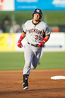 Kevin Torres (35) of the Hickory Crawdads rounds the bases after hitting a home run against the Kannapolis Intimidators at CMC-Northeast Stadium on May 19, 2014 in Kannapolis, North Carolina.  The Crawdads defeated the Intimidators 10-6.  (Brian Westerholt/Four Seam Images)