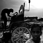 """Mumbai, the city symbolic of the Indian miracle and its sustained economic growth, will become, in 2020, the most populopus metropolis of the world. Today more than 40% of its inhabitants lives in the various slums and shantytowns that define the urban landscape of this Indian """"megacity""""Among the slums, the best known is Dharavi, thanks also to the international success of the Slumdog Millionaire movie. The main street of Dharavi, May 10, 2007  Dharavi is a shantytown with one of the highest demographic densities of the world, also known as the largest in Asia...  Children of the slums.."""