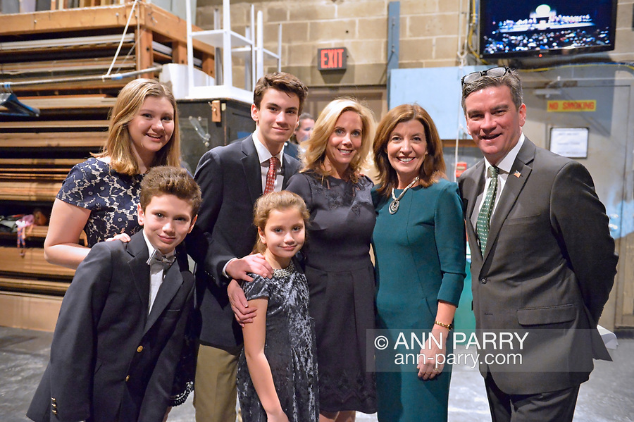Hempstead, New York, USA. January 1, 2018. In green, New York State Lt. Governor KATHY HOCHUL poses with LAURA GILLEN and her husband CHRIS GILLEN and their four children shortly before the Swearing-In of Laura Gillen as Hempstead Town Supervisor at Hofstra University. It was first time a Democrat became Town of Hempstead Supervisor in over a century.