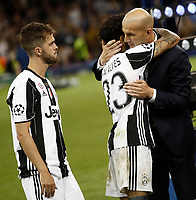Calcio, Champions League: finale Juventus vs Real Madrid. Cardiff, Millennium Stadium, 3 giugno 2017.<br /> Real Madrid's coach Zinedine Zidane, right, is congratulated by Juventus' Dani Alves, center, past his teammate Miralem Pjanic, at the end of the Champions League final match between Juventus and Real Madrid at Cardiff's Millennium Stadium, Wales, June 3, 2017. Real Madrid won 4-1.<br /> UPDATE IMAGES PRESS/Isabella Bonotto