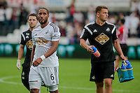 Saturday 20th September 2014  Pictured:  ` dejected looking Ashley Williams of Swansea City  leaves the field after losing to Southampton <br /> Re: Barclays Premier League Swansea City v Southampton  at the Liberty Stadium, Swansea, Wales,UK