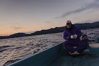 Fisherman Rikio Kikugawa setting out to sea, harvesting wakame at dawn, Awata fishing port, Naruto, Tokushima Prefecture, Japan, February 4, 2012.