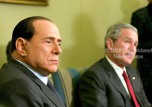 Washington, D.C. - February 28, 2006 -- United States President George W. Bush meets Prime Minister Silvio Berlusconi of Italy in the Oval Office of the White House on February 28, 2006..Credit: Ron Sachs / CNP