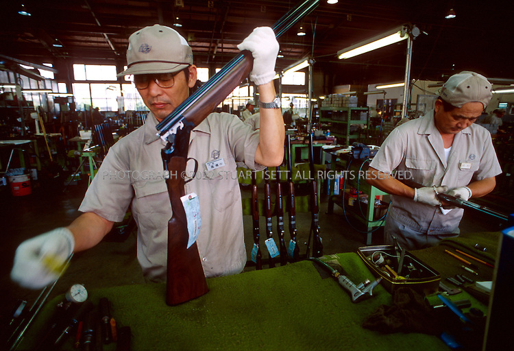 9/29/2000--Koichi, Japan..A n employee at Miroku, a Japanese guin manufacturer, puts the final touches on shot guns made in the company's plant in southern Japan....All photographs ©2003 Stuart Isett.All rights reserved.This image may not be reproduced without expressed written permission from Stuart Isett.
