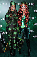 WEST HOLLYWOOD, CA - OCTOBER 29: Christina Milian, Shenae Grimes at 3rd Annual Midori Green Halloween Party held at Bootsy Bellows on October 29, 2013 in West Hollywood, California. (Photo by Xavier Collin/Celebrity Monitor)