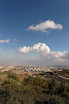 Israel, Jerusalem, A view of the Judean desert from the eastern side of Mount Scopus. Ma'ale Adumim is seen behind the Palestinian neighborhood El Azzariya
