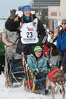 Anna Berington and team leave the ceremonial start line with an Iditarider at 4th Avenue and D Street in downtown Anchorage, Alaska on Saturday, March 5th during the 2016 Iditarod race. Photo by Joshua Borough/SchultzPhoto.com
