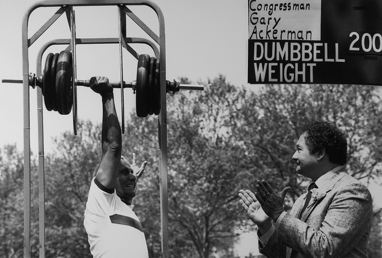 Sri Chinmoy lifts Rep. Gary Ackerman's, D-N.Y., body weight of 200 lbs, on May 20, 1988. (Photo by CQ Roll Call via Getty Images)