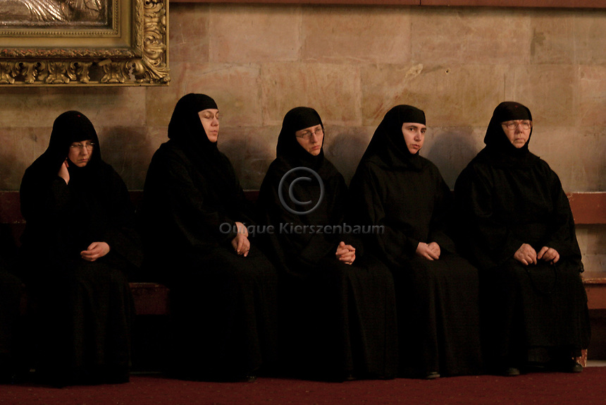 Greek Orthodox Nuns are seen during a mass in the Holy Sepulcher, in the Old City of Jerusalem, March 19, 2006.