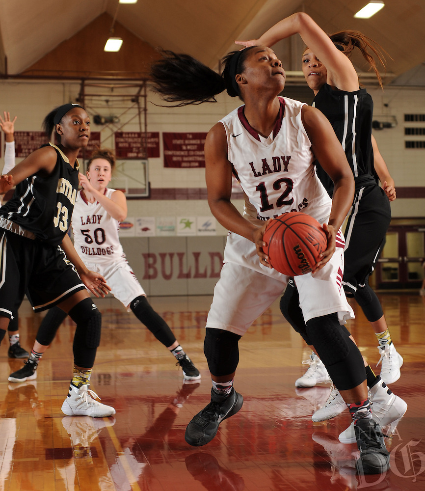 NWA Democrat-Gazette/ANDY SHUPE<br /> Maya Hood (12) of Springdale makes a post move around Kiara Williams of Little Rock Central Tuesday, Nov. 24, 2015, at Bulldog Gymnasium in Springdale. Visit nwadg.com/phtoos to see more photographs from the game.