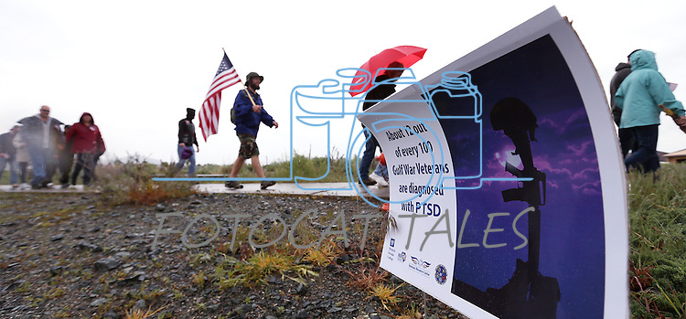 More than 120 people participate in the Western Nevada College 2nd annual Suicide Awareness March in Carson City, Nev. on Saturday, May 7, 2016. The event raises awareness about the average 22 veteran suicides each day in the U.S. and the local services available to help. <br /> Photo by Cathleen Allison/Nevada Photo Source