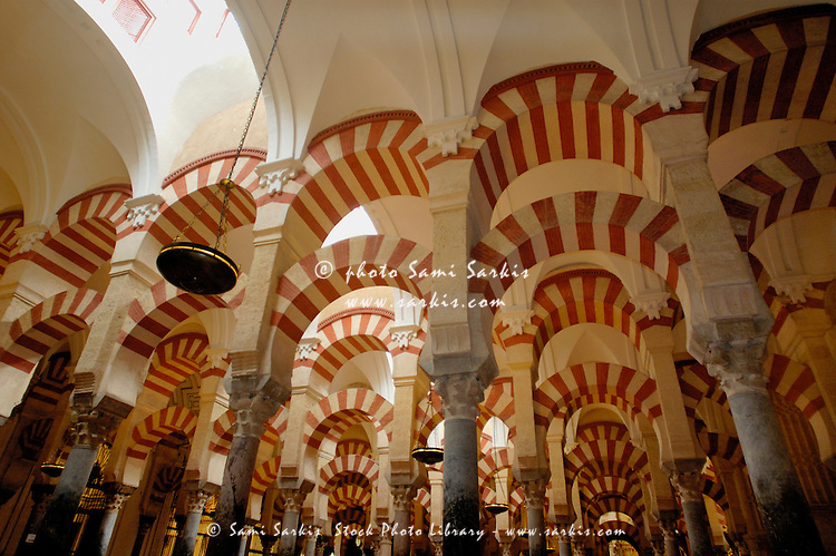 Striped ceiling arches inside the Catedral de Cordoba, a former medieval mosque, Cordoba, Andalusia, Spain.