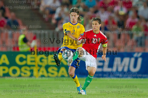 Sweden's Mikael Lustig (L) and Hungary's Tamas Hajnal (R) fight for the ball during the UEFA EURO 2012 Group E qualifier Hungary playing against Sweden in Budapest, Hungary on September 02, 2011. ATTILA VOLGYI
