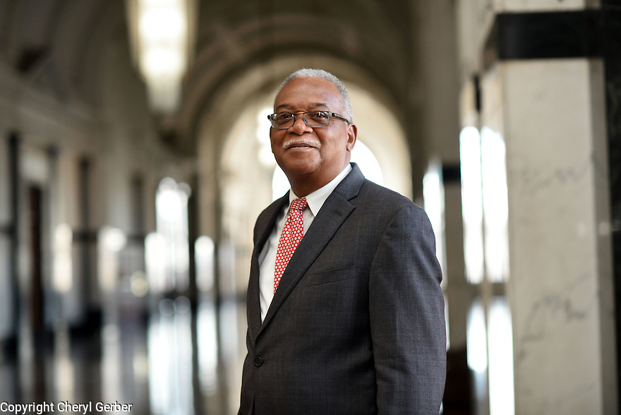 Retired Criminal Court Judge Calvin Johnson stands in the Grand Hall of Orleans Parish Criminal Court.