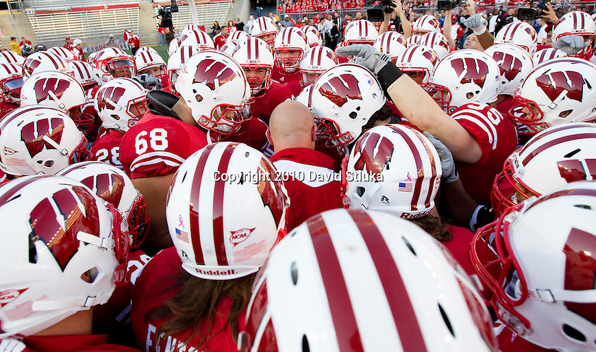 Wisconsin Badgers football team huddles prior to an NCAA college football game against the Ohio State Buckeyes on October 16, 2010 at Camp Randall Stadium in Madison, Wisconsin. The Badgers beat the Buckeyes 31-18. (Photo by David Stluka)