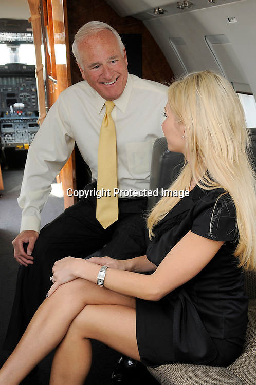 Man and woman in conference on corporate jet