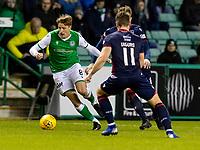 12th February 2020; Easter Road, Edinburgh, Scotland; Scottish Premiership Football, Hibernian versus Ross County; Vykintas Slivka of Hibernian takes on Iain Vigurs of Ross County