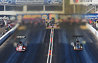 Oct. 15, 2011; Chandler, AZ, USA; NHRA top fuel dragster driver Shawn Langdon (left) races alongside David Grubnic during qualifying at the Arizona Nationals at Firebird International Raceway. Mandatory Credit: Mark J. Rebilas-