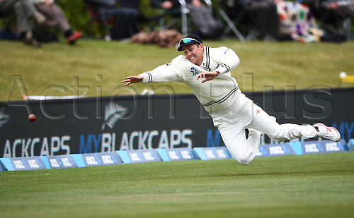 14.12.2015. Dunedin, New Zealand.  Trent Boult dives in the out field as he attempts a catch during play on day 5 of the 1st cricket test match between New Zealand Black Caps and Sri Lanka at University Oval, Dunedin, New Zealand. Monday 14 December 2015.
