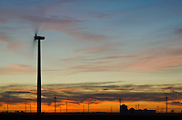 A Wind Turbine turns in at sunset on a November day in a wind farm in  Benton County, Indiana