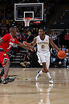 Codi Miller-McIntyre (0) of the Wake Forest Demon Deacons is guarded by Terry Rozier (0) of the Louisville Cardinals during first half action at the LJVM Coliseum on January 4, 2015 in Winston-Salem, North Carolina.  The Cardinals defeated the Demon Deacons 85-76.  (Brian Westerholt/Sports On Film)