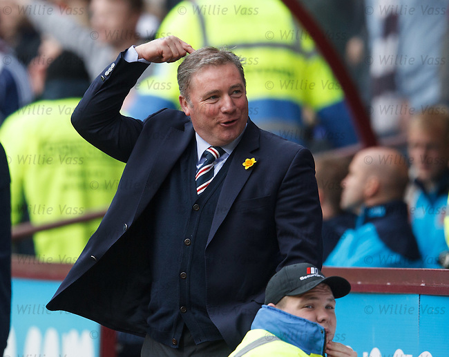 Rangers boss Ally McCoist enjoys some banter with the Hearts fans behind the dugout who are teasing him about his bald spot on his head