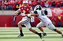29 October 2011: Taylor Martinez #3 of the Nebraska Cornhuskers tries to avoid being tackled by Max Bullough #40 of the Michigan State Spartans at Memorial Stadium in Lincoln, Nebraska.  Nebraska defeated Michigan State 24 to 3.