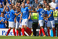 Jamal Lowe of Portsmouth second left is mobbed after scoring the first goal during Portsmouth vs Luton Town, Sky Bet EFL League 1 Football at Fratton Park on 4th August 2018