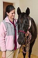 Mississippi State University, College of Veterinary Medicine, Class of 2015, Sagen Gunnoe with equine patient.