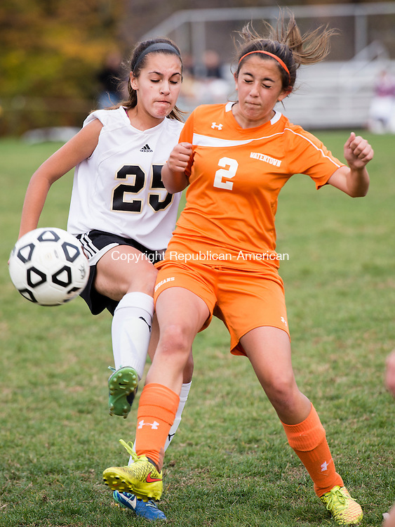 BEACON FALLS, CT- 22 October 2015-102215EC06-  Woodland's Maribella Sousa and Watertown's Adrianna Guerrera struggle trying to get possession of the ball Thursday in Beacon Falls. Erin Covey Republican-American