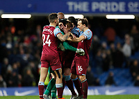 30th November 2019; Stamford Bridge, London, England; English Premier League Football, Chelsea versus West Ham United; Goalkeeper David Martin of West Ham United celebrates with Mark Noble, Ryan Fredericks, Declan Rice and Angelo Ogbonna of West Ham United after full time as West Ham United beat Chelsea 0-1 at Stamford Bridge  - Strictly Editorial Use Only. No use with unauthorized audio, video, data, fixture lists, club/league logos or 'live' services. Online in-match use limited to 120 images, no video emulation. No use in betting, games or single club/league/player publications