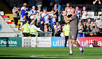 Lincoln City's first team goalkeeping coach Andy Warrington applauds the fans at the final whistle<br /> <br /> Photographer Chris Vaughan/CameraSport<br /> <br /> The EFL Sky Bet League One - Lincoln City v Bristol Rovers - Saturday 14th September 2019 - Sincil Bank - Lincoln<br /> <br /> World Copyright © 2019 CameraSport. All rights reserved. 43 Linden Ave. Countesthorpe. Leicester. England. LE8 5PG - Tel: +44 (0) 116 277 4147 - admin@camerasport.com - www.camerasport.com