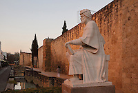Statue of Abu al-Walid ibn Ruchd, known as Averroes, 1126-98, holding a book, author of treatises on medicine, mathematics, astronomy, ethics and philosophy, on a marble pedestal by the Almodovar Gate in the city walls in Cordoba, Andalusia, Southern Spain. The historic centre of Cordoba is listed as a UNESCO World Heritage Site. Picture by Manuel Cohen