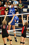 SIOUX FALLS, SD - NOVEMBER 5:  Taryn Kloth #12 from O'Gorman winds up for a kill between Sara Tvedt #10 and Kara Robbins #9 from Brookings in the second game of their District 1AA game Tuesday night at O'Gorman (Photo by Dave Eggen/Inertia)