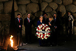 US Secretary of State Hillary Clinton lays a wreath next to the Eternal Flame at the Hall of Remembrance in the Yad Vashem Holocaust Memorial Museum in Jerusalem, Tuesday, March 3, 2009. Earlier today, Clinton declared that the US will work closely with any new Israeli government, and emphasized the necessity of a two-state solution to the Israeli-Palestinian conflict. Throughout the day, she is scheduled to meet with Prime Minister-designate Binyamin Netanyahu, Prime Minister Ehud Olmert, Foreign Minister Tzipi Livni and Defense Minister Ehud Barak. Photo By: Daniel Bar On / JINI.