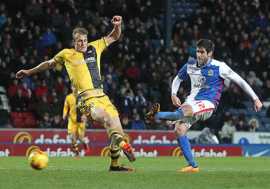 Blackburn Rovers Danny Graham gets a shot on goal as Fulham's Dan Burn dives in<br />