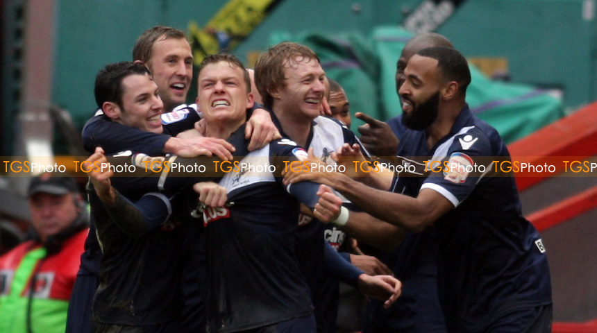 Shane Lowry of Millwall FC is mobbed by teamates after scoring midfielder second goal - Charlton Athletic vs Millwall - NPower Championship Football at the Valley, London - 16/03/13 - MANDATORY CREDIT: Helen Watson/TGSPHOTO - Self billing applies where appropriate - 0845 094 6026 - contact@tgsphoto.co.uk - NO UNPAID USE.