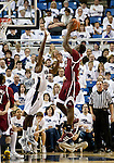 March 1, 2012: New Mexico State Aggies center Tshilidzi Nephawe shoots over Nevada Wolf Pack forward Dario Hunt during their NCAA basketball game played at Lawlor Events Center on Thursday night in Reno, Nevada.