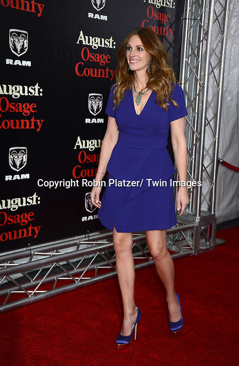 "Julia Roberts in Provenza Schoeller purple dress attends the New York Premiere of ""August: Osage County"" on December 12, 2013 at the Ziegfeld Theatre in New York City."