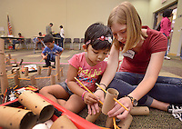 NWA Democrat-Gazette/BEN GOFF @NWABENGOFF<br /> Abby Terlouw, teen volunteer, helps Drishya Dinesh Archanaa, 3, of Bentonville build with pencils and cardboard tubes on Saturday Sept. 12, 2015 during the Invention Convention tinkering program at the Bentonville Public Library. The library supplied materials and resources for children and families to engage their 'inner inventor' and create whatever their imaginations could come up with.