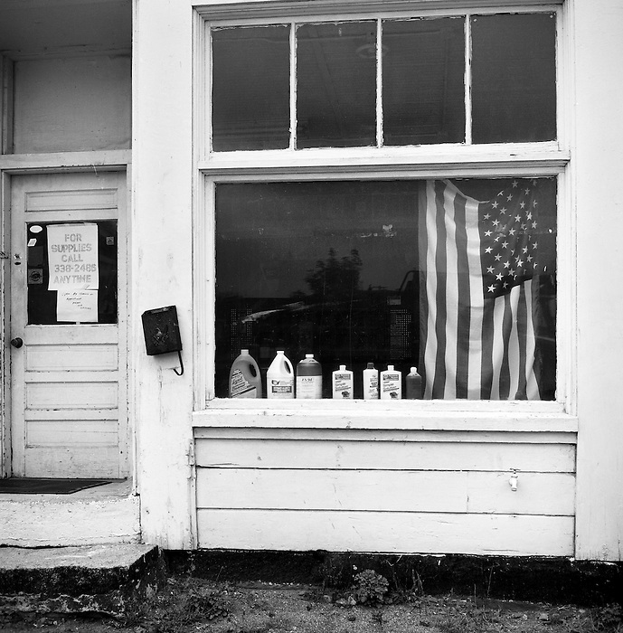 An American Flag in a Cleaning Supply Store Front Window