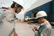 October 1984. In Shanghai Harbor, Mitsubishi Japannesse trucks are imported.